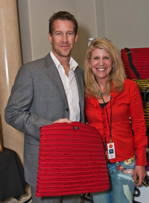 James Denton holding the Backpack Messenger Bag