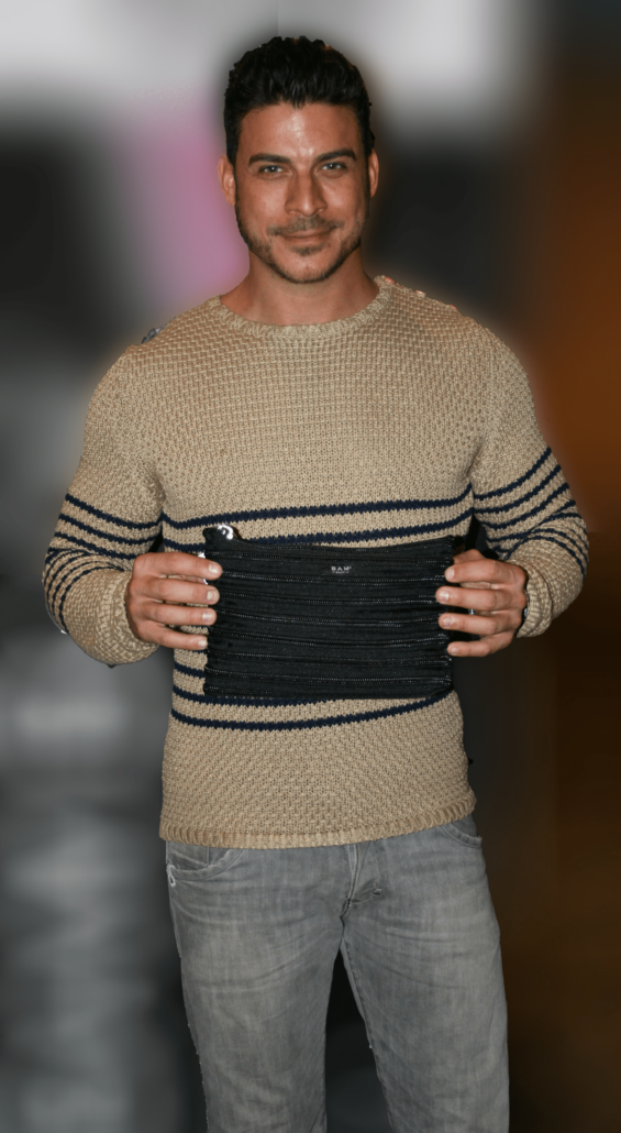 Jax Taylor holding his Carryall Pouch