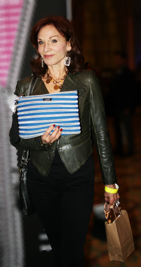 Marilu Henner holding up her Carryall Pouch