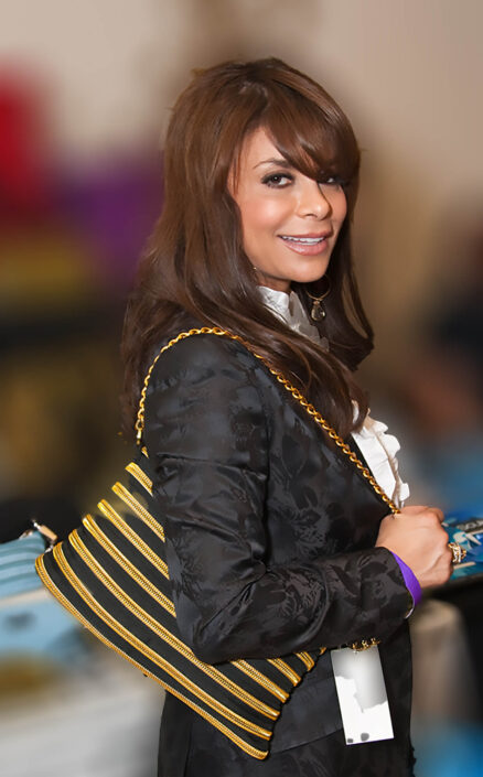 Paula Abdul wearing a gold zippurse